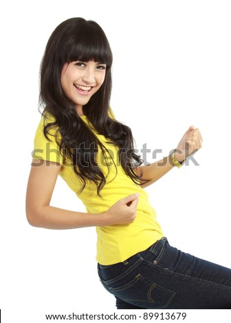 Portrait of happy young woman showing a happy gesture on white background - stock photo