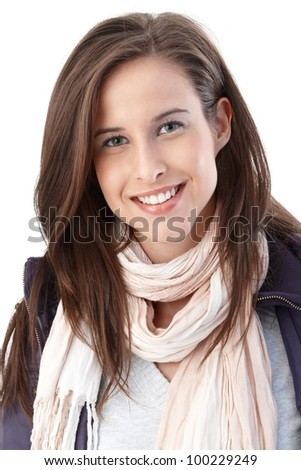 Portrait of happy young woman wearing trendy scarf and casual jacket smiling at camera. - stock photo