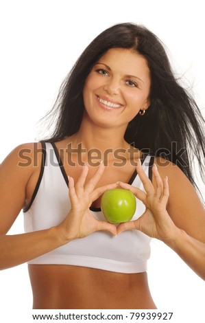 Portrait of happy young woman with green apple - stock photo
