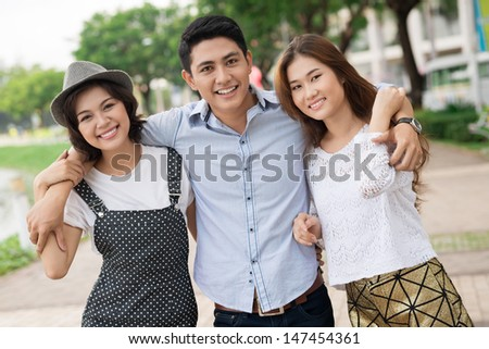 Portrait of happy youngsters bonding and looking at camera - stock photo