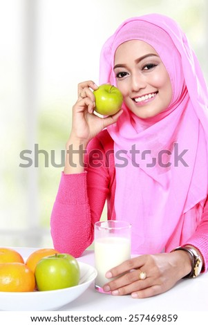 portrait of healthy breakfast of young muslim woman - stock photo