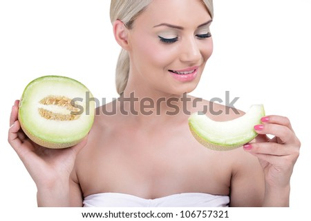 Portrait of healthy smiling woman holding a slice of cantaloupe - stock photo