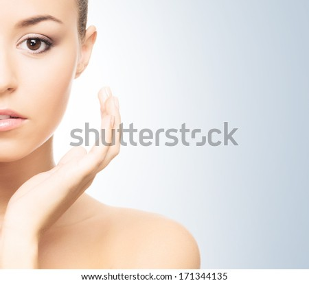 Portrait of healthy, young and beautiful woman in spa style