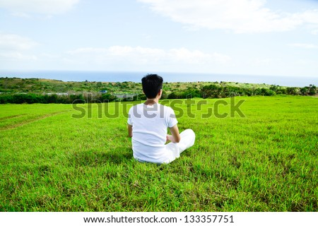 portrait of healthy young man doing yoga back - stock photo