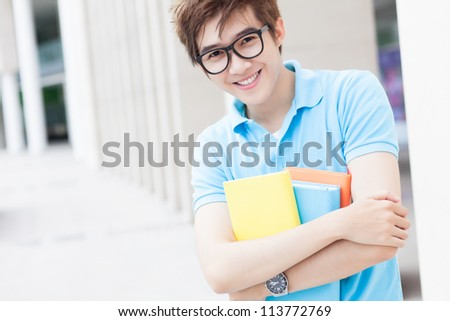 Portrait of high school student with books looking at camera