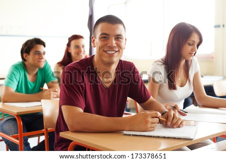 portrait of high school students discuss during the class  - stock photo