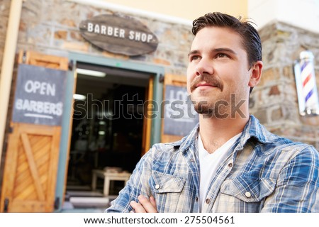 Portrait Of Hipster Barber Standing Outside Shop - stock photo