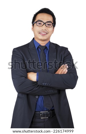 Portrait of hispanic businessperson crossed hands in studio, isolated on white - stock photo