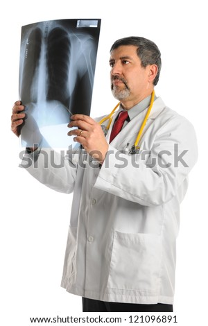 Portrait of Hispanic doctor looking at X-ray film isolated over white background