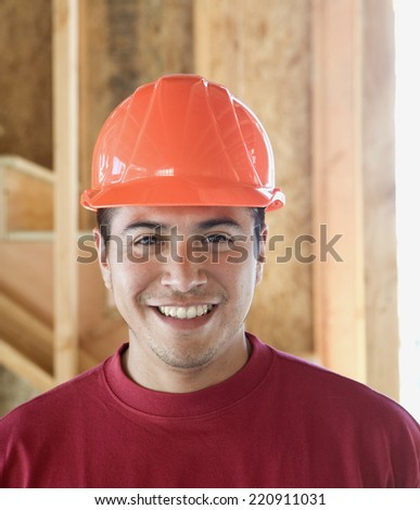 Portrait of Hispanic male construction worker - stock photo