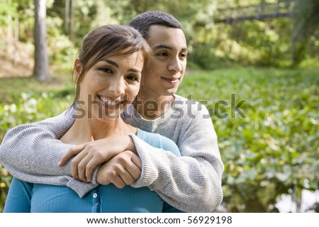 Portrait of Hispanic mother and teenage son outdoors in park