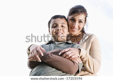 Portrait of Hispanic mother and 10 year old son outdoors - stock photo