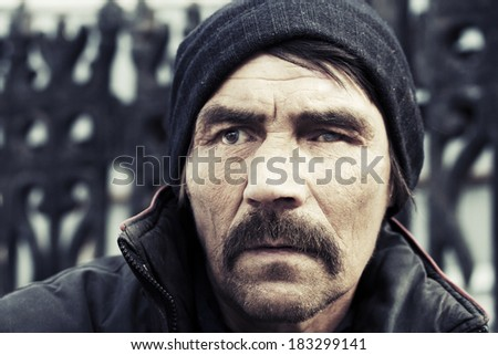 Portrait of homeless man in depression  - stock photo