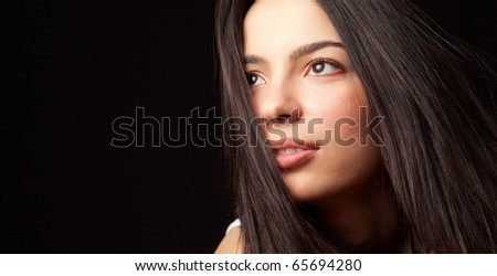 Portrait of hopeful young cute student woman - stock photo