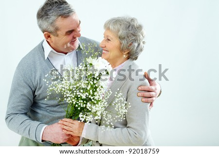 Portrait of husband giving bouquet of flowers to wife at Woman?s day