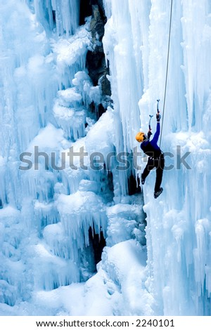 portrait of ice climber - stock photo