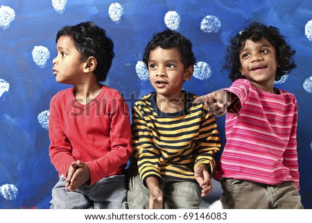 portrait of indian children on a blue background - stock photo
