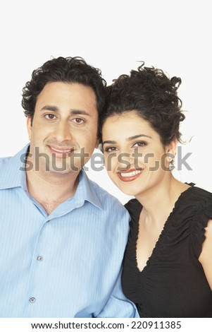 Portrait of Indian couple hugging - stock photo