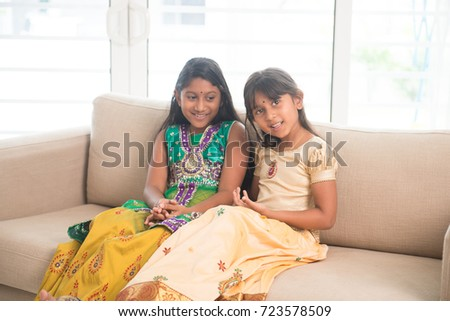 Portrait of Indian family bonding at home. Happy Asian children indoors lifestyle.