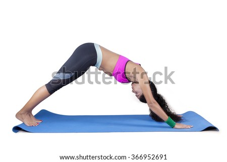 Portrait of indian woman practicing yoga isolated on white background