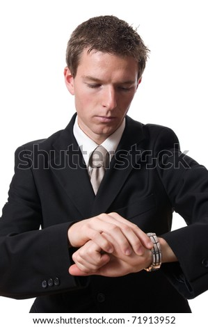 portrait of inexpressive businessman looking at his watch isolated on white background - stock photo