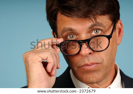 Portrait of Inquisitive business man with glasses