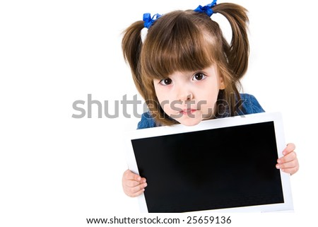 Portrait of intelligent schoolgirl showing something on laptop screen and looking at camera - stock photo