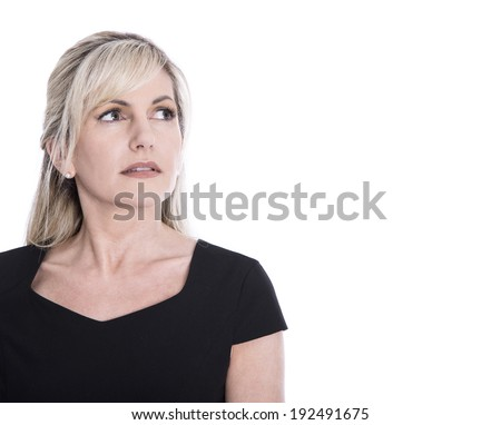 Portrait of isolated mature woman face looking sorrowful and pensive. - stock photo