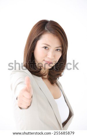 portrait of japanese business woman going thumb up