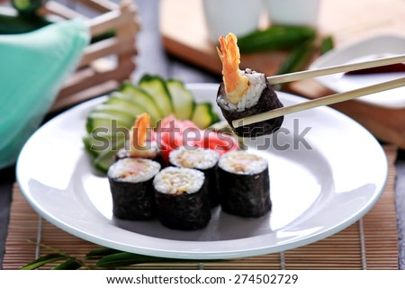 portrait of japanese cuisine ebi roll sushi served with zucchini and wasabi - stock photo