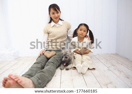 Portrait of Japanese mother and child and dog - stock photo