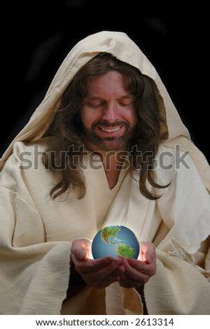 Portrait of Jesus holding the world with dark background - stock photo