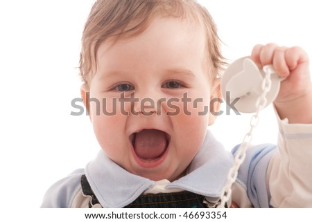 Portrait of joyful baby boy with pacifier over white