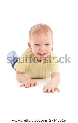 Portrait of joyful boy lying over white background