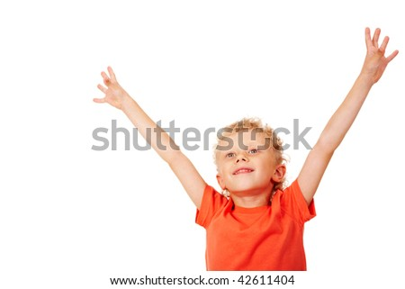 Portrait of joyful boy raising his arms - stock photo