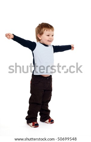 Portrait of joyful boy with raised arms - stock photo