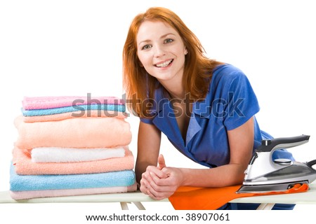 Portrait of joyful female looking at camera during housework