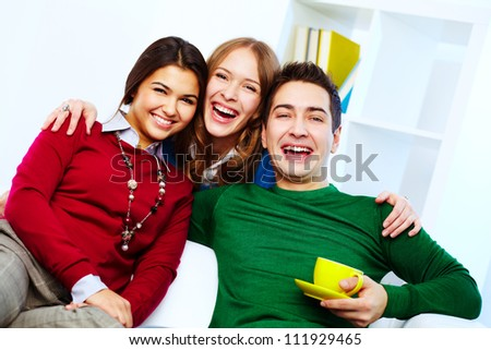 Portrait of joyful friends looking at camera - stock photo