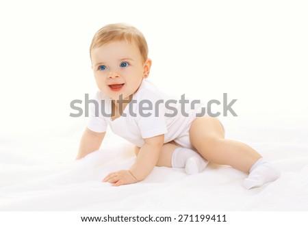 Portrait of joyful happy cute baby playing and crawls - stock photo