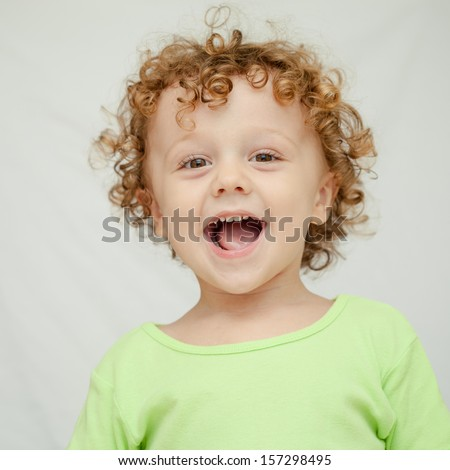 Portrait of joyful little boy - stock photo