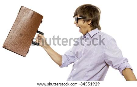 Portrait of joyful man brandishing his suitcase - stock photo