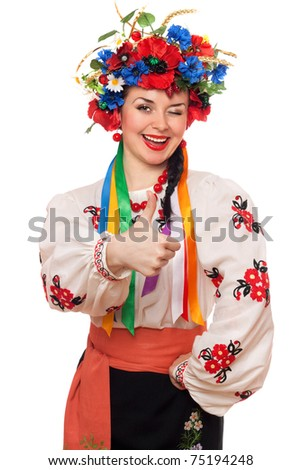 Portrait of joyful young woman in the Ukrainian national clothes - stock photo
