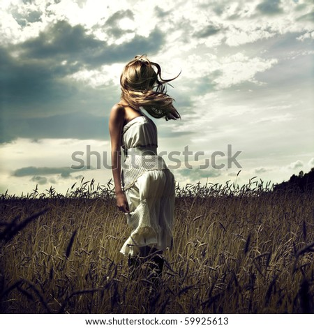 Portrait of jump women in wheat field - stock photo