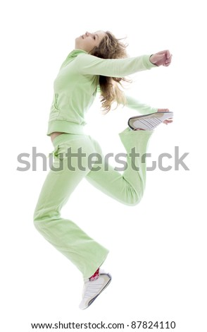 Portrait of jumping girl in sportsuit