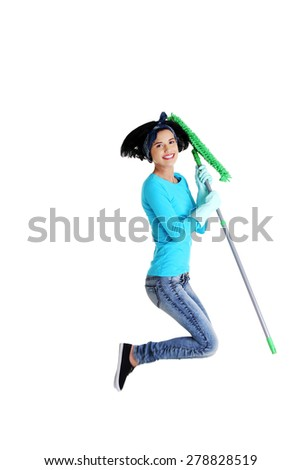 Portrait of jumping woman with a mop. - stock photo