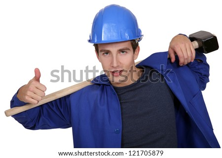 portrait of junior carpenter with hammer - stock photo