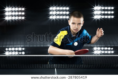 Portrait Of Kid Playing Tennis On Black Background - stock photo
