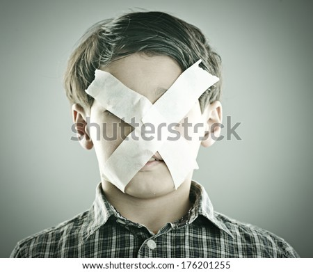 Portrait of kid with x shape on his face - stock photo