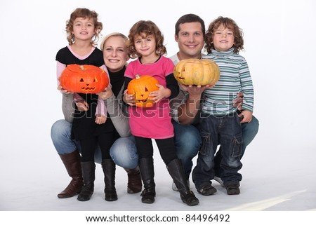 portrait of kids with pumpkins - stock photo