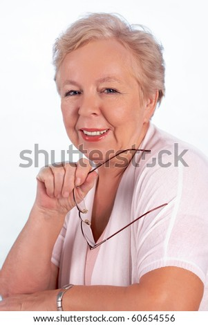 Portrait of kind and friendly woman with eyeglasses looking at camera